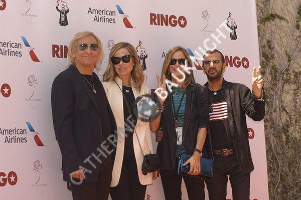 At Ringo Starr's Peace and Love Celebration Ringo (far right) celebrates with (left to right) Joe Walsh and wife Marjorie Bach, and Barbara Bach (Ringo's wife) at Capitol Records in Hollywood, California.