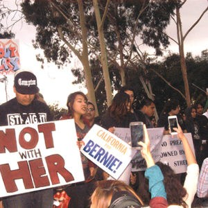 Hillary Clinton visits East Los Angeles College on her campaign trail for President amid protesters.  Clinton vowed to raise national minimum wage and create jobs.  Many from the Latino community were there to support her.  A large rally of Clinton protesters were outside of the event.  Many of them were Bernie Sanders supporters.